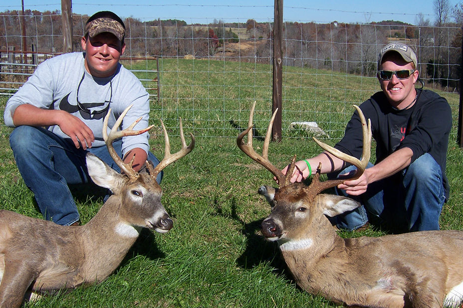 Two hunters with their deer at Long Creek Outfitters