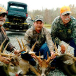 A group of men pose with their deer at Long Creek Outfitters